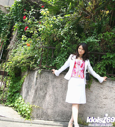 Totally dressed Japanese sweetmeat flashing her priceless jugs and bush outdoor