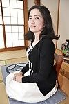 Miyoko Tanigawa is featured in a sticky undressing scene in her living room