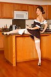 Teen Oriental girl in maid\'s uniform and nylons strutting in kitchen
