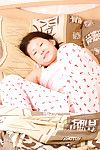Oriental infant Dia wakes up from sleeping to undress in nature\'s garb for as was born pictures