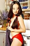 Brunette hair girl with an watertight waste Tiger Lily shows off her feel like legs