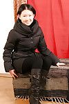 Korean principal timer Dia posing perfectly covered in leather boots and leggings