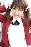 Lusty Japanese coed in uniform flashing her underclothing and compact love muffins