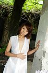 Japanese pretty Minami Aikawa uncovering her mini mambos and bushy snatch outdoor