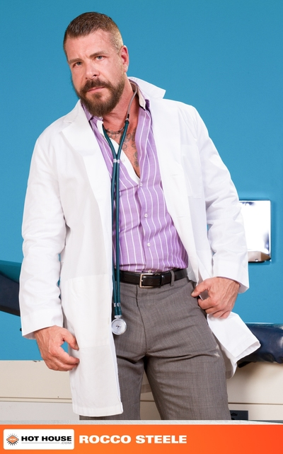 When Colt Rivers finds out everything is fine with his test results, he questions why Dr. Rocco Steele called him down to his office. The answer is obvious when Dr. Rocco walks from behind his desk, exposing the massive bulge in his pants. Colt is flatter