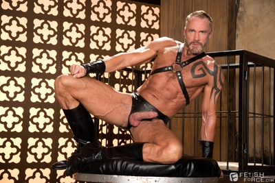 Mike De Marco is confined to a cage, fitted with puppy gear complete with a tail, a puppy hood, collar and puppy paw pads. His master Dallas Steele releases Mike from the cage and leads him by leash to a waiting water bowl. When pup Mike spills his water,