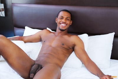 High up in a luxurious skyscraper, lovers Krave Moore and Jordano Santoro get cozy above the bustling metropolis.  As Krave takes in the myriad sights and sounds from the balcony, Jordano joins him, nuzzling up from behind.  They both become very turned o