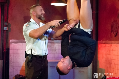 Jessie Colter hangs from the ceiling by his ankles, like a side a beef. He
