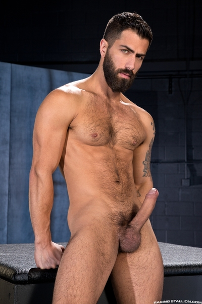 Sticks jutting skywards, Adam Ramzi and Dario Beck make a shaggy connection as they kiss. Adam, lean and full-bearded, strokes he