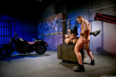 Damien Crosse leans against a wall in a shady alley, his taut bicep showing off a raw tattoo. A tag on slides across his motorcycle. Damien