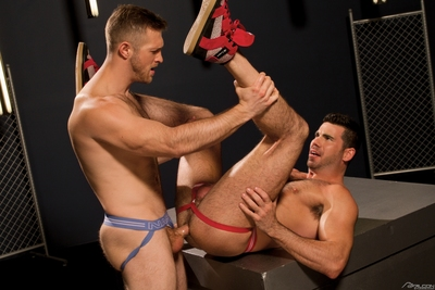 Beefy Billy Santoro forces his thick, black hair against Paul Wagner