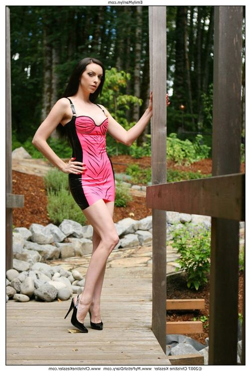 Fetish case Emily Marilyn stripping out of latex nude in the forest