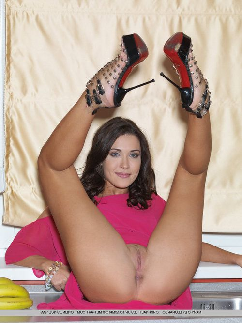 Slim raven-haired angel Mary C loves stretching her sexy long legs
