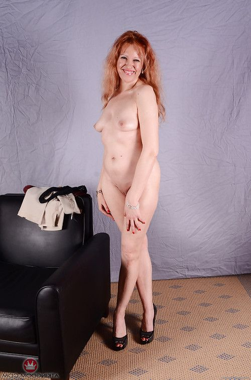 Older redhead babe with small tits sliding panties away from shaved snatch