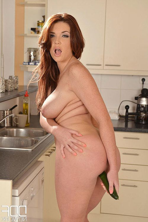 Emma Leigh fucks her pussy with a cucumber in the kitchen