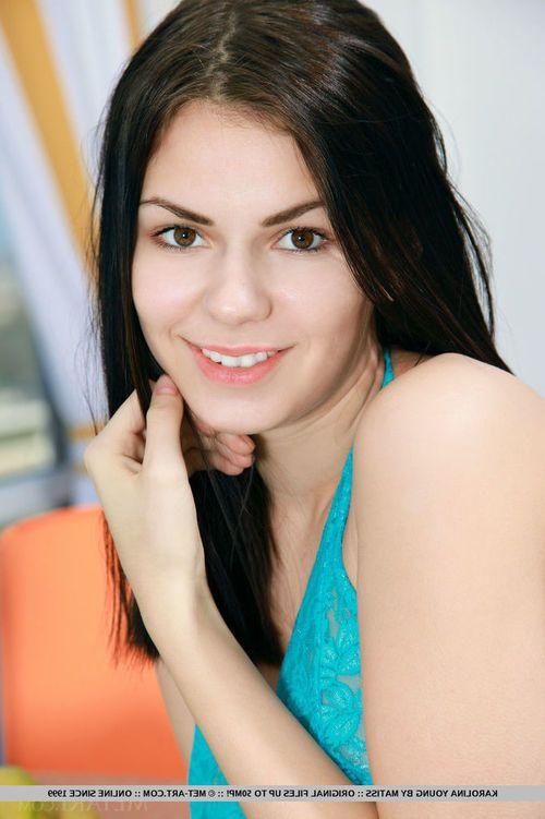 Gorgeous teen Karolina Young removes lace panties to show pink gentile closeup
