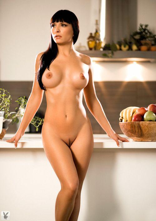 Brunette hottie Darija Milanovic uncovering her big titties and petite ass