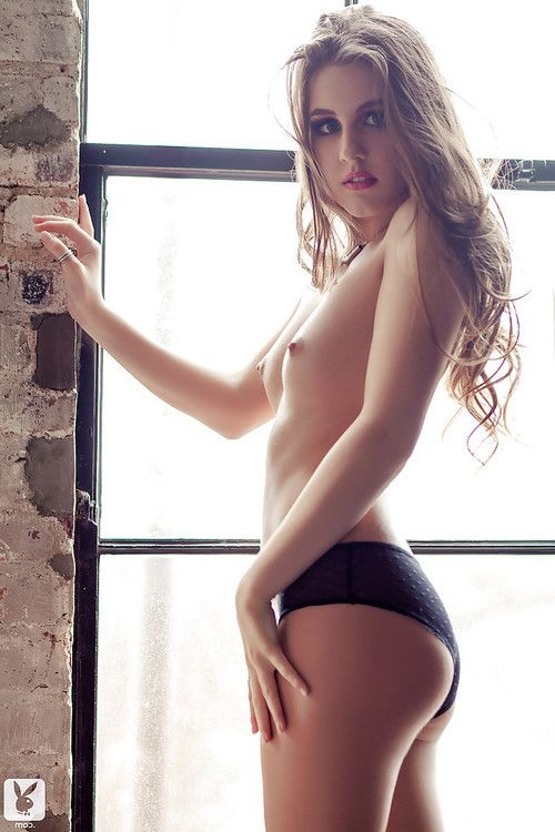 Pretty centerfold brown hair in black lingerie showing her body