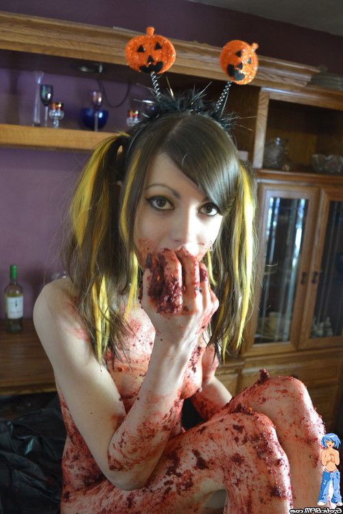 Beautiful teen halloween caking mess