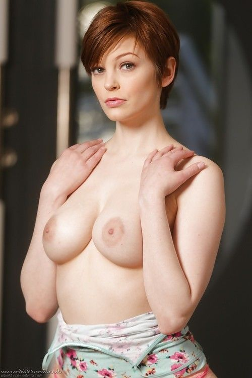 Short haired redhead in pink panties unveiling total all natural breasts