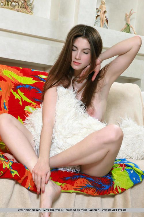 Busty young brunette Marta divulges her inflexible body on the sofa