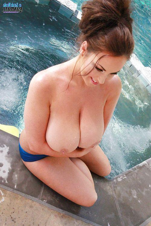 Big boobed centerfold model Sarah Nicola Randall posing topless outdoors