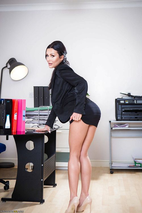 Buxom brunette office babe Patty Michova flaunting sexy legs and firm ass