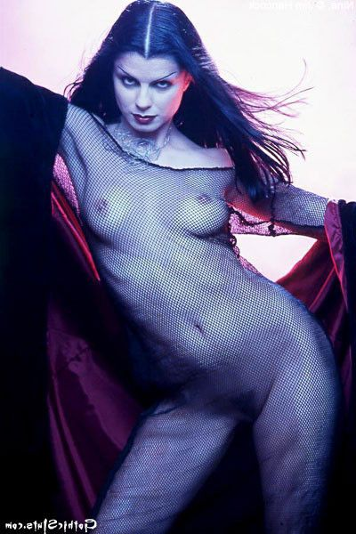 Witchy girl in fishnet disrobes undressed outdoors