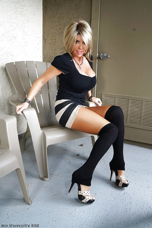 Aged housewife Sandra Otterson posing in OTK socks for babe pics