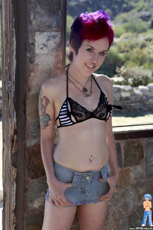 Adorable petite raver dear strips out of her mini skirt outdoors