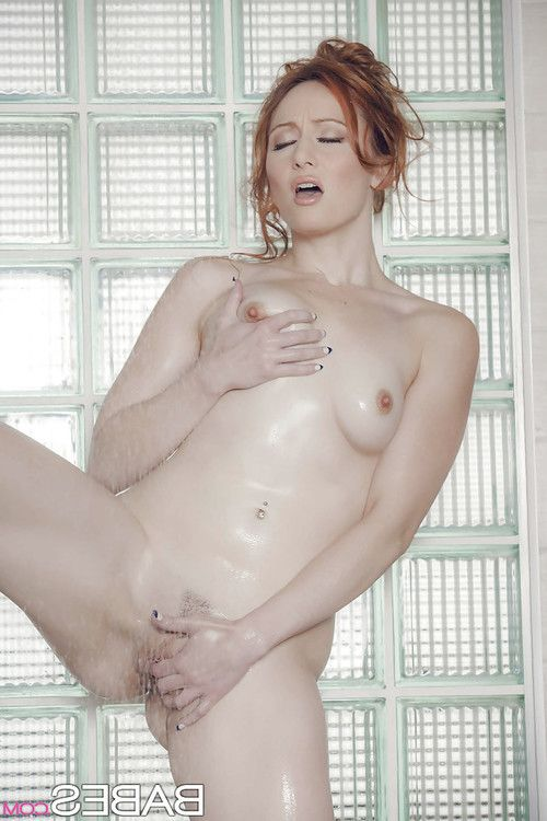 Naked redhead Crystal Clark lets washroom water run over compact tits and bush