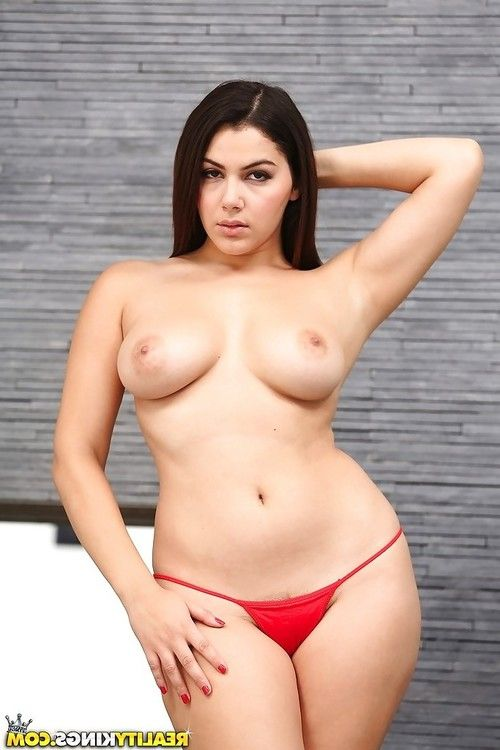 Yoga g-string attired brunette babe Leah Gotti exposing perfect big tits