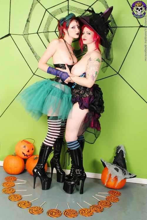 Two kinky witches giving halloween spankings