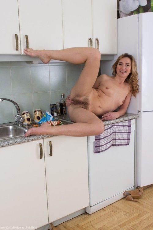 Melisa is a sexy Latvian miniscule blonde who is wearing a sexy floral dress in the kitchen. She slowly strips naked and purchases naked on the counter. She shows off her hairy fur pie and rubs her hairy lips.