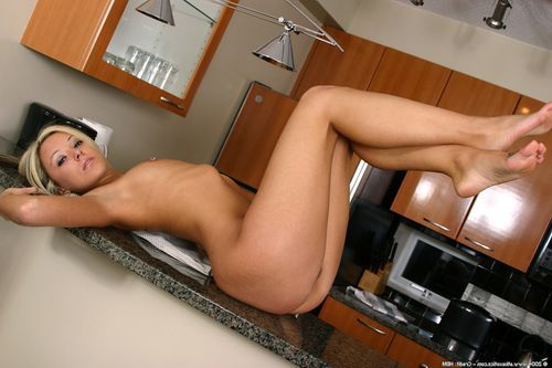 Teen Latina babe Chrissy baring tiny tits and pierced nipples in kitchen