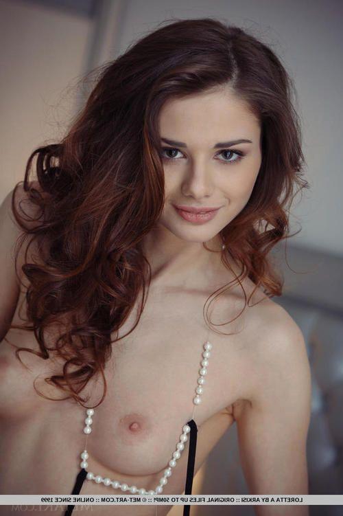 Lovely brunette looker Loretta enjoys showing off her clammy cunt