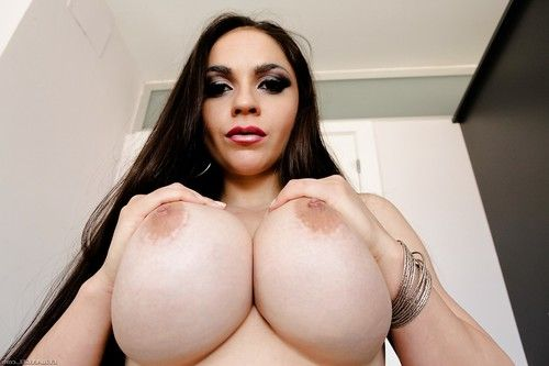 Big busty Marta La Croft drops underclothes to give hot view of her big round ass