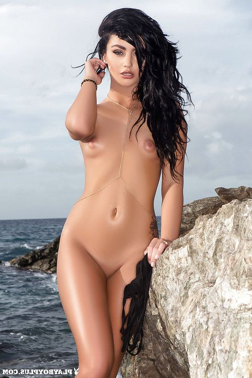 Beach cutie Kristie Taylor freeing miniature love bubbles for outdoor centerfold spread