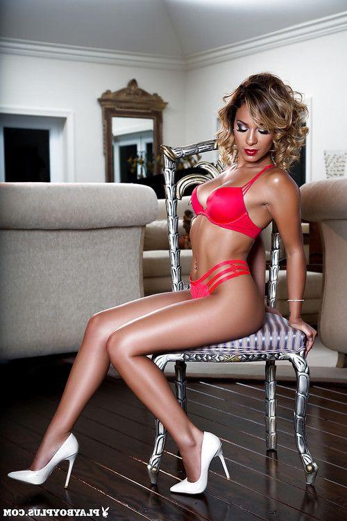 Amateur tanned model Alisette Rodriguez poses on her high heels