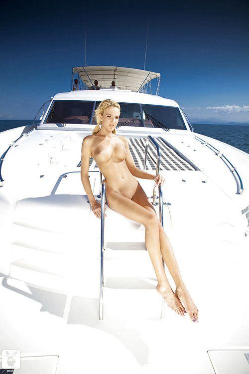 Stunning centerfold demonstrating her goods on the boat walk