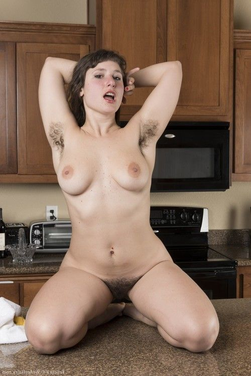 Done cleaning in the kitchen, Felicia F strips and climbs on the counter in her lingerie and denim shorts. On the counter, she gets naked to show off her sexy all-natural body whole of hairy beauty for us.