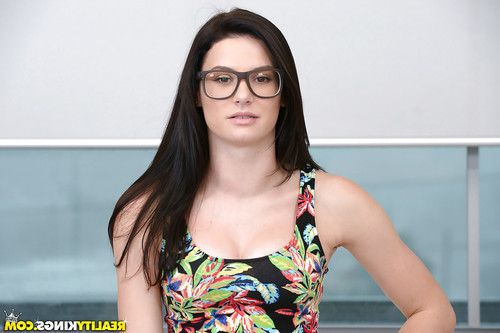 Glasses clad amateur solo girl Kymberlee Anne showing off phat ass in strap