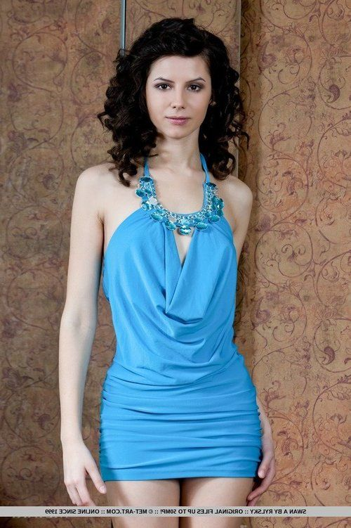 Thin dark haired glam model Swan A unveiling skinhead slit underside dress
