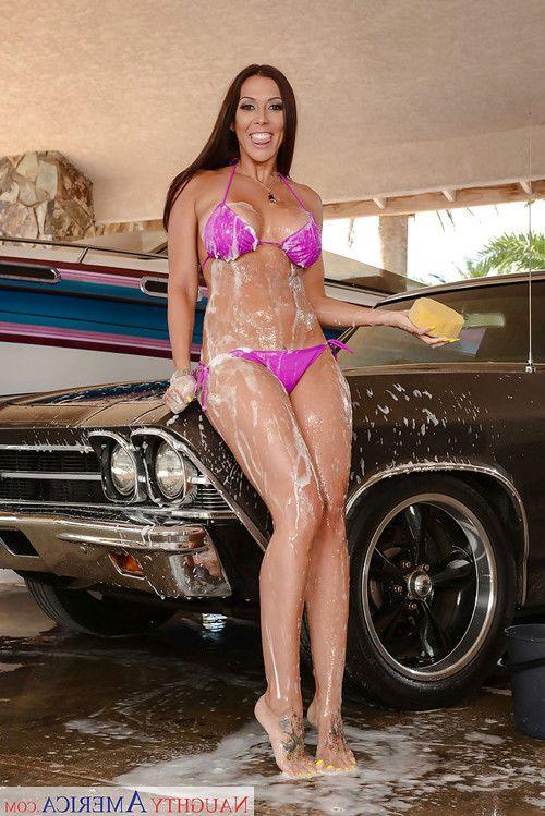 Wet housewife Rachel Starr freeing immense MILF boobs from bikini for babe photos
