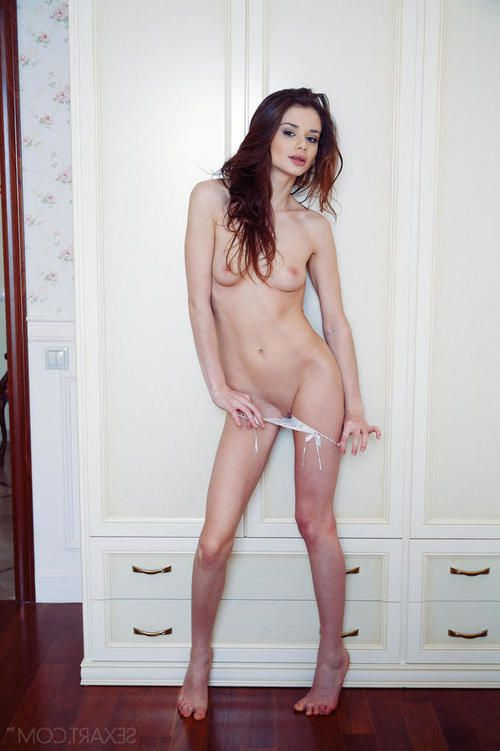 Skinny dark brown lass loves spreading her orgasmic pink slit