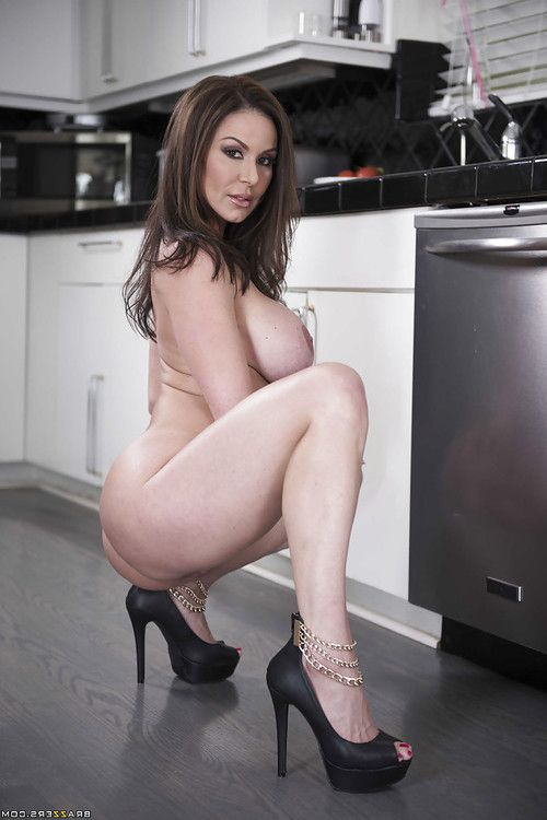 Hot wife Kendra Lust exposing large MILF tits in kitchen during babe spread