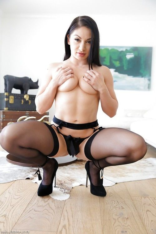 European chick Lea Lexis wearing heels and nylons showing her round wazoo