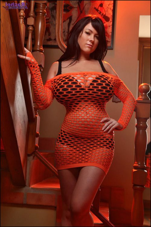 Rounded brunette beauty Rachel pose in fishnet dress for holloween