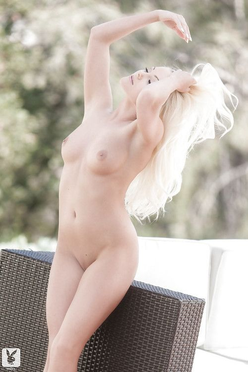 Seductive golden-haired babe Andrea English captivating off her bikini outdoor