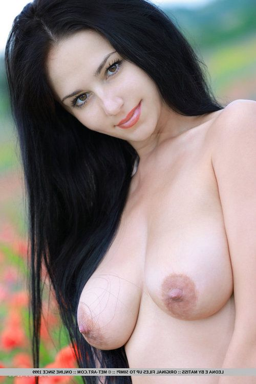 Alluring raven-haired looker Leona E unveils her perfectly round tits